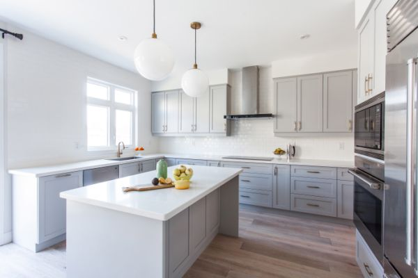 New Light Grey Shaker With Pearl White Quartz Counter Top